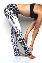 Tribal leggings high waisted extra long yoga pants with exotic black and white tribal design made from premium eco friendly fabrics. Side view. Available from Uniquely Yoga Boutique