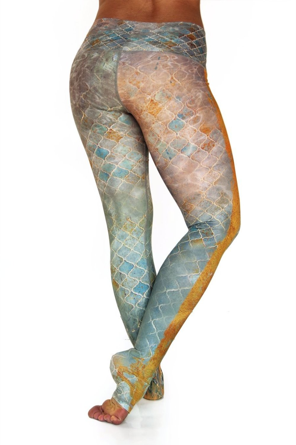 Sahara leggings high waist extra long soft compression fabrics in desert tile multi color design. Blue tan and pink asymmetrical design with yellow stripe down single leg from Niyama Sol. Available from Uniquely Yoga. Back View