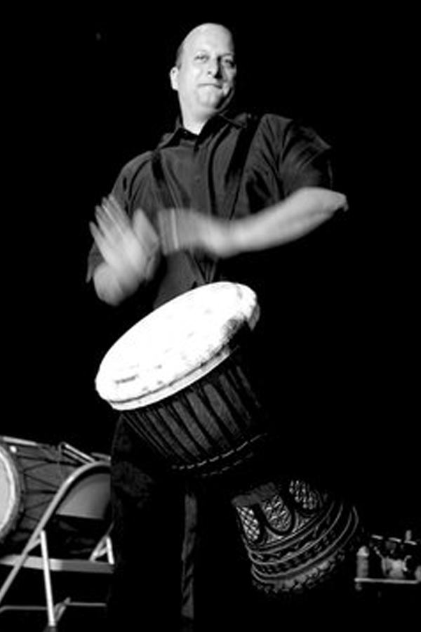 Michael Markus playing a djembe drum