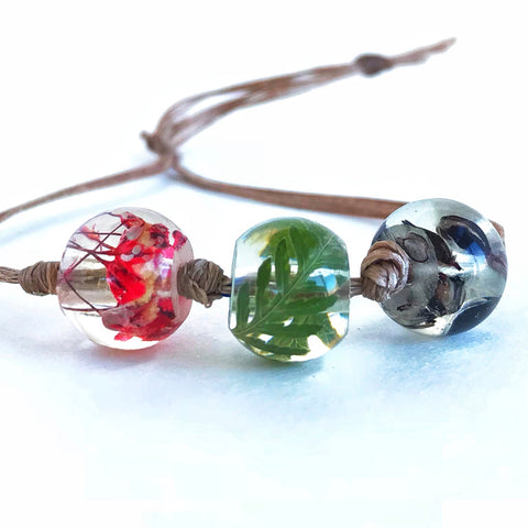 DIY Bead Bracelet  - Red, Green and Black Botanical Resin Beads on Waxed Cord