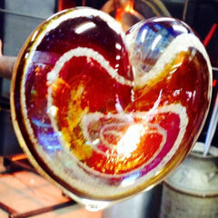 glass heart paperweight with ash
