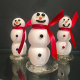 Blown glass snowman trio
