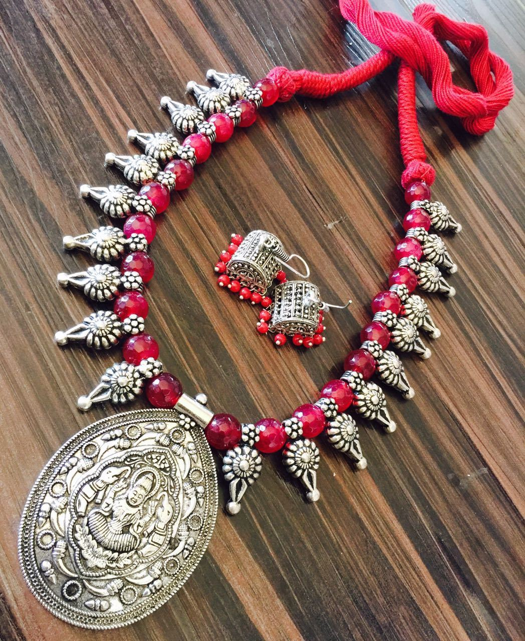 Red Glass Beaded Necklace with Hook Jhumka and Lakshmi Design Pendant