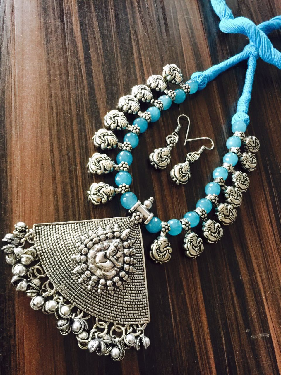 Sky Blue Glass Beaded Necklace with Hook Earring and Ganapathi Design Pendant with Ghungaroo Droppings