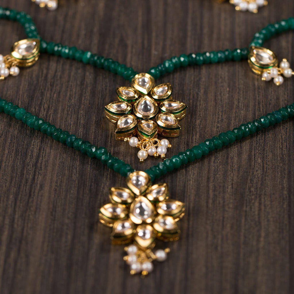 Multi layered 22 K Gold Plated High Quality Kundan And Emerald Set