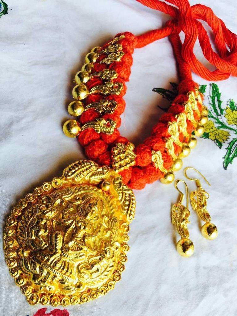 Oxidised Gold Lakshmi Design Temple Necklace Set With Orange Dori