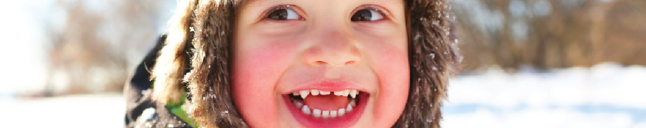 Child with rosy cheeks