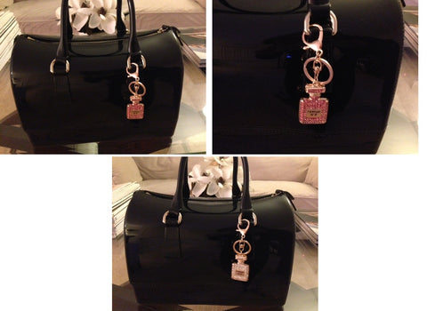pov of parfum charms on purse