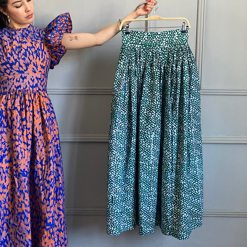 model wearing the azumi cotton maxi cotton skirt by sika london