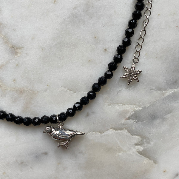 black onyx beaded charm necklace with silver gouldian finch bird