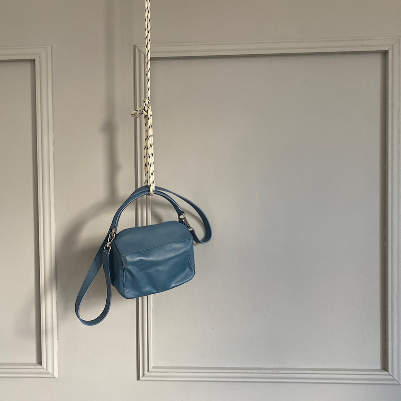 mascerati leather shoulder bag in denim blue by johnny ramli