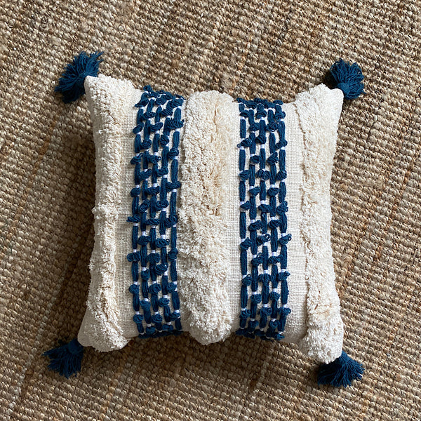 on the water blue and white stripe embroidered tufted cotton cushion cover with tassels