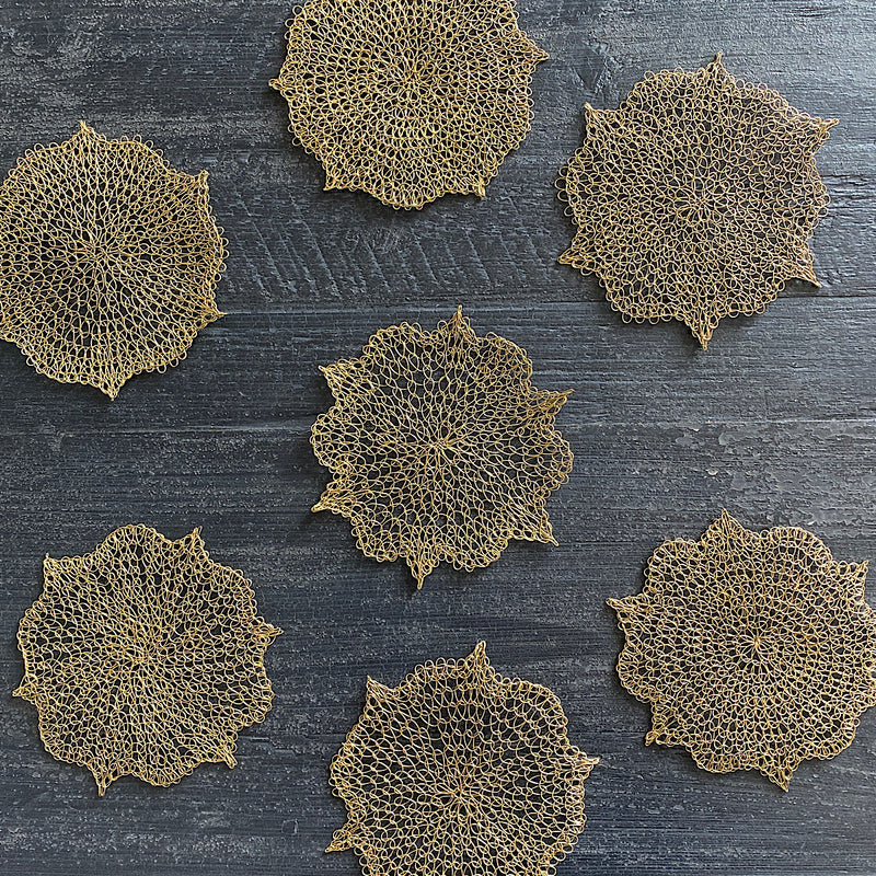 hand crocheted mesh wire drink coaster in gold