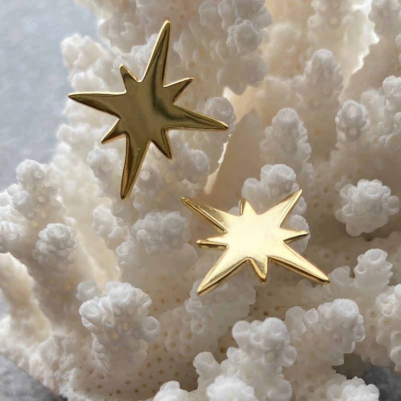 bursting star gold stud earrings
