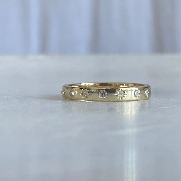 crystal star encrusted gold ring band