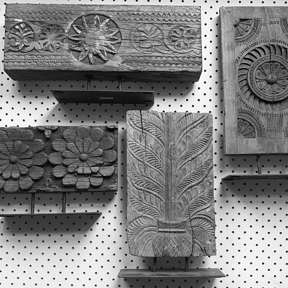 image of assorted vintage Indian repurposed hand carved wooden brackets on stands