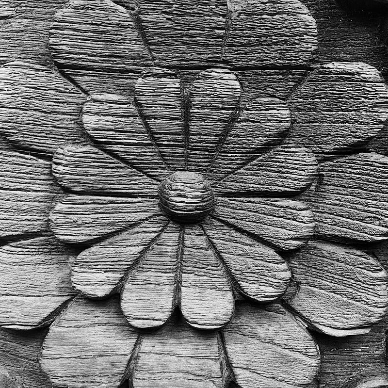 detail of a vintage Indian repurposed hand carved wooden bracket on stand