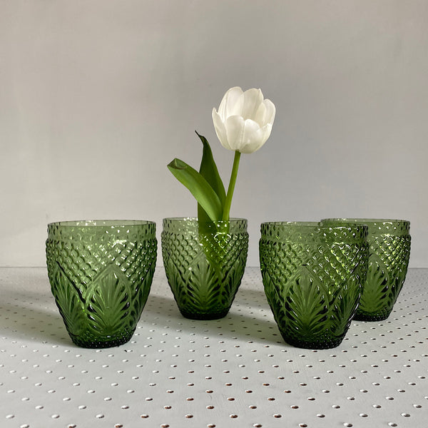 four green vintage style embossed glass tumblers