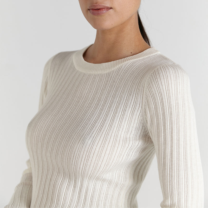 model wears the ana ribbed cotton merino wool knit top from marle clothing