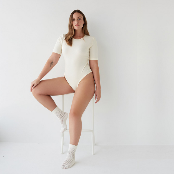 dear dylan luxury loungewear ribbed cotton bodysuit in french vanilla