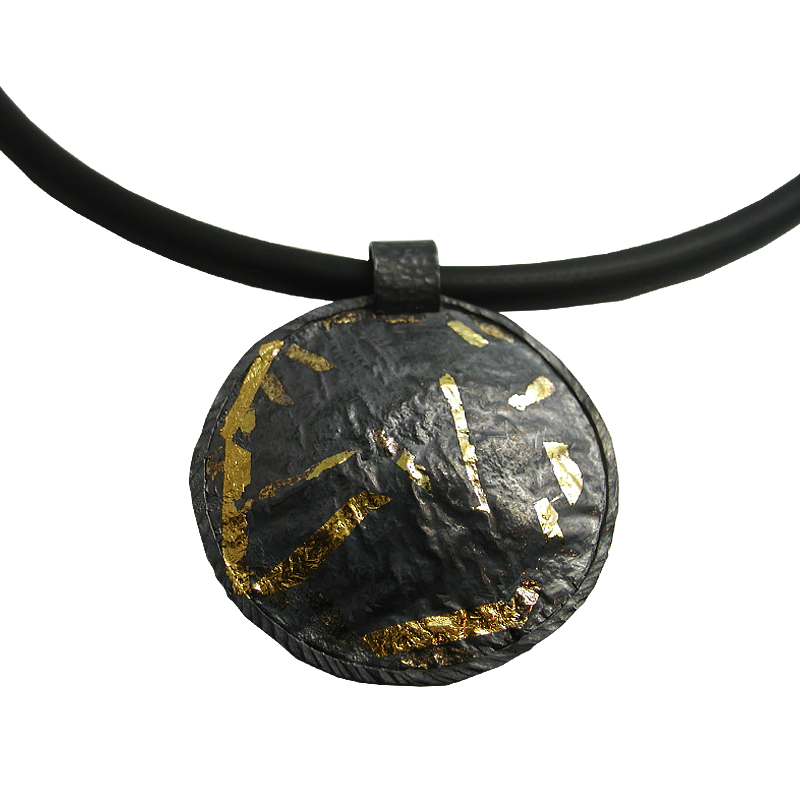 Large round circle of silver with gold and black.  Textured and silky.