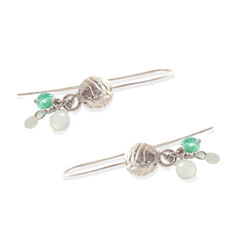 Earrings with both a smooth and grainy feel.  Colors are silver and turquoise blue.