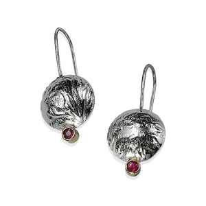 Textured reticulated silver with red rubies. The earrings feels like soft tree bark.
