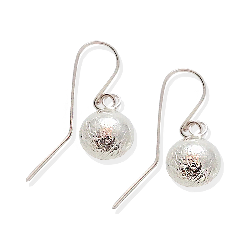 Textured reticulated silver circles with sterling ear wires.   Textured and silky.