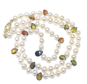 Silky smooth white pearls with fall colored tourmalines.