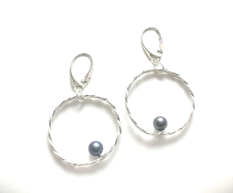 Braided silver with silky gray pearl accents.   These earrings hang on Leverbacks.