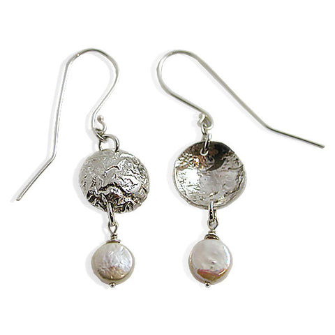 Textured reticulated silver metal with smooth coin shaped pearls.