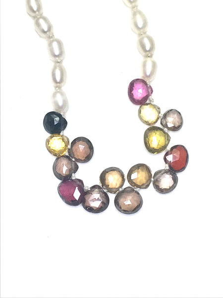 Zoom shot of fall colored spinels with white texture potato shaped pearls