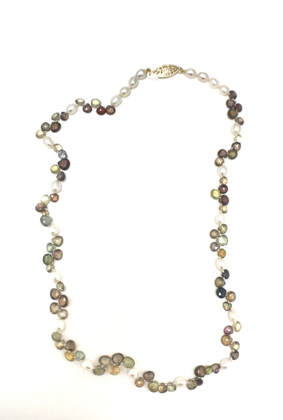 Pearls and fall colored spinel stones.  Yellows, purples, reds, greens and white.