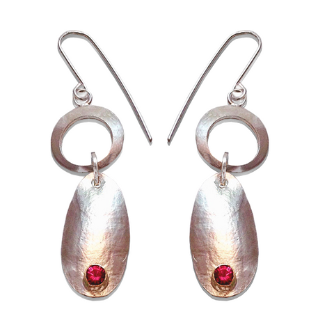 Earrings with a silky and smooth texture.  Three hanging components of sterling silver and pink tourmalines set in 14KY gold.   Kinetic and fun earrings to ear and see.