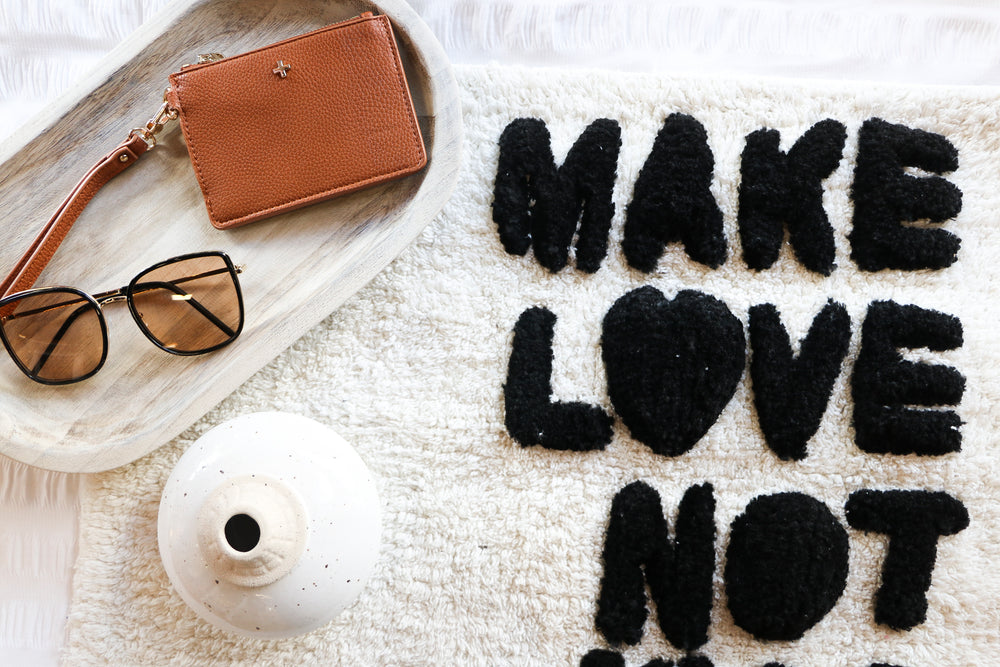 Load image into Gallery viewer, Make Love Not War Bathmat (charcoal)