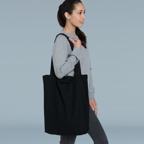 6422339fec0 The Carrie Bag is a tote bag made from heavy cotton canvas so it can hold  everything from organic groceries to your volcanic rock collection or even  a small ...