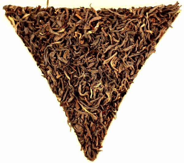 Indian Assam Kamakhya Orange Pekoe Loose Leaf Quality Tea Gently Stirred