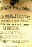 Ethiopian Bench Maji Organic Fair Trade Coffee Beans Gently Stirred