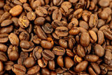 Ethiopian Harrar Cheffe Jenata Unwashed Fair-Trade Organic Whole Coffee Beans Gently Stirred