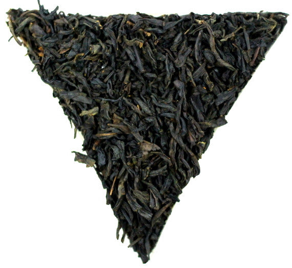Chinese Lapsang Souchong Roasted Tea Gently Stirred