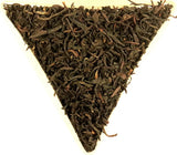 Lapsang Souchong Tarry Organic Loose Leaf Smoked Black Tea Gently Stirred