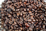 Premium Espresso Swiss Water Decaffeinated Whole Coffee Beans Gently Stirred