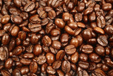 Vanilla Cream Flavoured Whole Coffee Beans Gently Stirred