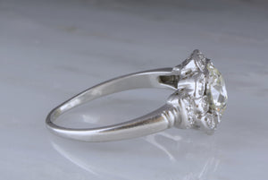 1.65ctw Edwardian Platinum Engagement Ring with Pre Art Deco Design Motifs; 1.40ct Old European Cut Diamond Center