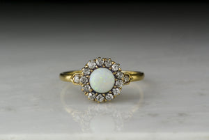Antique Victorian 18K Rose-Yellow Gold Engagement or Anniversary Ring with an Opal Center and Old Mine Cut Diamond Halo