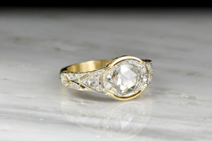 Ornate Belle Époque Two-Toned Gold and Platinum Diamond Ring with Ornate Metalwork