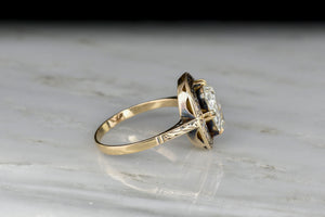 Late Victorian Oval Rose Cut Diamond Ring with an Engraved Halo