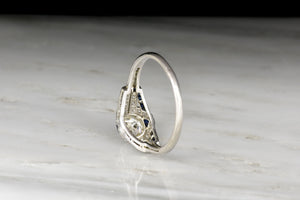 Art Deco Diamond and Sapphire Ring with a Transitional Cut Diamond Center