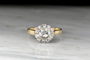 Victorian Gold and Silver Diamond Cluster Ring with a Rose Cut Diamond Center