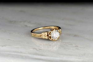 Late Victorian Eight-Prong Buttercup Solitaire with a GIA .87 Carat Old European Cut Diamond